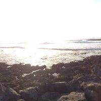 Photo taken at chamopoint beach by Ali Alejandro C. on 2/6/2014