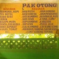 Photo taken at Sate dan ikan bakar Pak Otong by Rie A. on 12/23/2013