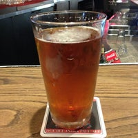 Photo taken at Oggi's Pizza & Brewing Company by Chris R. on 2/26/2013
