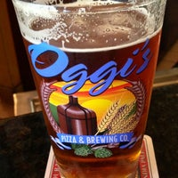 Photo taken at Oggi's Pizza & Brewing Company by Chris R. on 3/1/2013