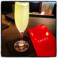 Photo taken at Fred's at Barneys New York by Colleen D. on 2/23/2013