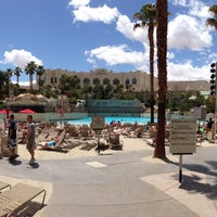 Photo taken at Mandalay Bay Beach by AJ G. on 5/7/2013