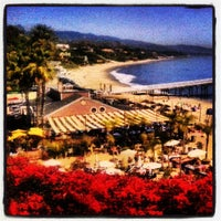 Photo taken at Paradise Cove Beach Cafe by HTEDance on 3/18/2013