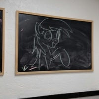 Photo taken at Gumby's Pizza by Alpha S. on 9/4/2014