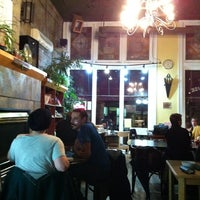 Photo taken at Mondragon Bookstore and Coffee House by KT S. on 10/24/2012