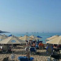 Photo taken at Vouliagmeni Beach by ΘΗΣΕΑΣ on 7/26/2015