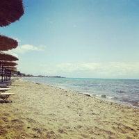 Photo taken at Ibiza Beach Bar by Vasso . on 6/7/2015