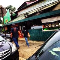 Photo taken at RM Ibu Haji Cibubur by hendra n. on 2/15/2014