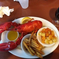 Photo taken at Lobsterman's Wharf by elise on 7/5/2014