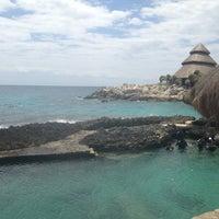 Photo taken at Playa Xcaret by Yamder R. on 3/28/2013