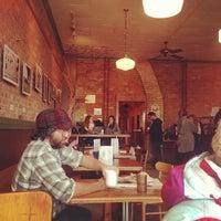 Photo taken at Black Cat Coffeehouse by Derek K. on 10/6/2012