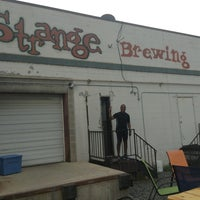 Photo taken at Strange Craft Beer Company by Wilbert C. on 6/29/2013