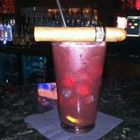 Photo taken at LIT Premium Cigar Lounge by Michael D. on 2/11/2013