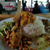 Photo taken at Warung Nasi Ayam Ibu Oki, Nusa Dua, Bali by Lorentia P. on 2/17/2017