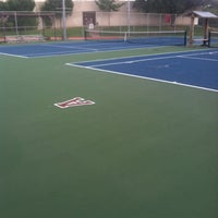 Photo taken at Austin High Tennis Center by Ruby M. on 7/25/2014