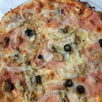 Photo taken at Pizzeria Minoa by Albert M. on 5/26/2013