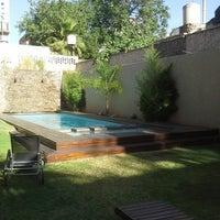 Photo taken at Villaggio Hotel Boutique Mendoza by Marcelo R. on 11/23/2013