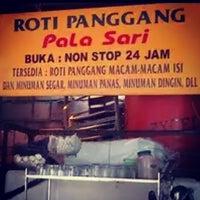 Photo taken at Roti Panggang Palasari by LEONARDO L. on 6/20/2014