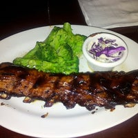 Photo taken at Tony Roma's: Ribs, Seafood & Steaks by Antonio G. on 7/23/2013