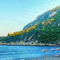Photo taken at Ermones Beach by Rauno R. on 8/30/2015