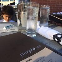 Photo taken at Purple Cafe & Wine Bar by Juliana D. on 7/31/2014
