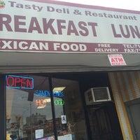 Photo taken at Tasty Deli by Jazeel B. on 10/18/2014