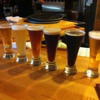 Photo taken at Outer Banks Brewing Station by Lilchelpz on 7/3/2012