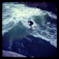 Photo taken at Eisbach Wave by Christian K. on 8/12/2012