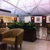 Photo taken at Emirates Lounge by Jack Thitinan on 8/25/2012