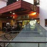 Photo taken at 4D Store by Alvaro P. on 4/7/2012