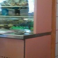 Photo taken at Omicron Family Restaurant by Deborah S. on 3/17/2012