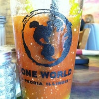 Photo taken at One World Eats & Drinks by Jacque on 8/25/2012
