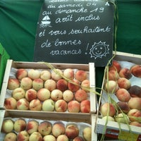 Photo taken at Marché de Raspail by Gabrielle M. on 7/22/2012
