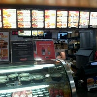 Photo taken at Carl's Jr by Marie C. on 4/12/2012