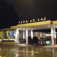 Photo taken at Baur au Lac by Mateusz on 7/6/2012