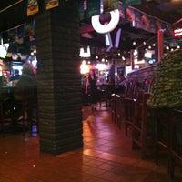 Photo taken at Q Restaurant & Sports Bar by Dan H. on 4/1/2012