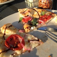 Photo taken at Brixx Wood Fired Pizza by Holly S. on 6/4/2012
