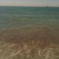 Photo taken at Playa Marina Beach by Esperanza M. on 7/28/2012