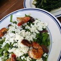 Photo taken at Village Taverna by Karen C. on 8/2/2012