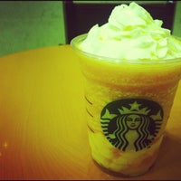 Photo taken at Starbucks by hirotomo on 7/8/2012