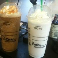 Photo taken at Starbucks by Christine M. on 5/19/2012
