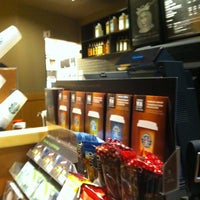 Photo taken at Starbucks by Simon T. on 3/12/2012