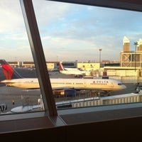 Photo taken at Delta Sky Club by Alex A. on 6/10/2012