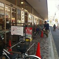 Photo taken at 関西スーパー 江坂店 by Kosei Y. on 4/8/2012