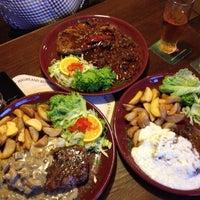 Photo taken at Highland Steak House by Maksym N. on 5/10/2012