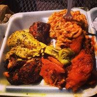Photo taken at Gigi & Big R Caribbean Soul Food Cart by Jake M. on 4/26/2014
