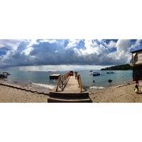 Photo taken at Pantai Senggigi by Serly C. on 12/29/2012