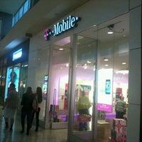 Photo taken at T-Mobile by Juanma C. on 12/21/2013