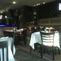 Photo taken at Napoli Italian Restaurant by Juanma C. on 4/26/2014