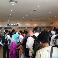 Photo taken at Immigration Office Arrivals Hall by Kenneth W. on 5/22/2014